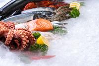 Fresh seafood on ice background.