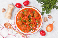 Meatballs with red bell pepper in garlic tomato sauce