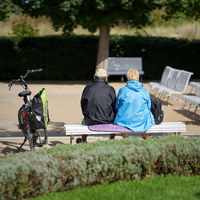 Pensioner couple on a park bench on the beach promenade in Heringsdorf in Germany