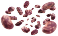 Red beans levitate on a white background