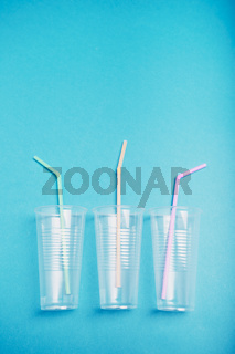 Empty plastic cups with colorful straws