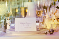 Wedding note card on plate at reception