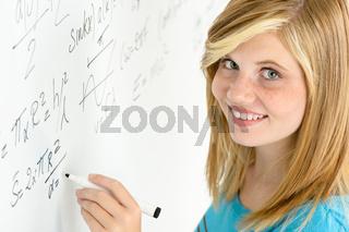 Student teenage girl write mathematics white board