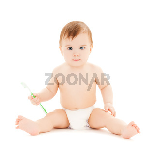curious baby brushing teeth