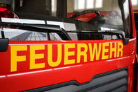 Front view of a fire engine car with the lettering fire department
