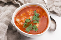 Tomato soup with rice decorated with parsley