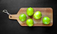Organic fresh limes on a cutting board