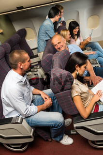 Leisure travel people enjoy flight airplane cabin