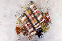 Various spices in glass bottles as ingredient for healthy food