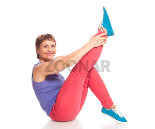 attractive woman 50 years doing fitness