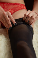 woman puts on stockings