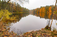 Finnish lake with mirror image in autumn