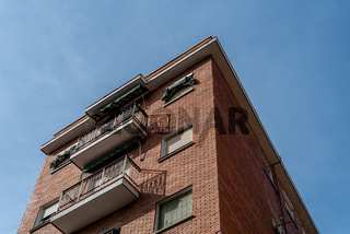 Brick residential building built in the 50's in the area of Embajadores in Madrid
