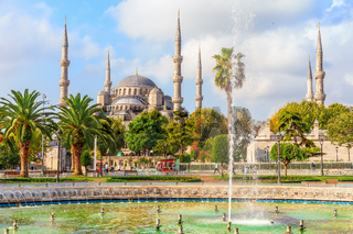 The Blue Mosque and the fountain in Sultan Ahmet park, Istanbul, Turkey
