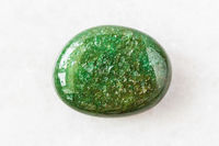 polished green Aventurine gem stone on white