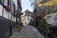 Paved narrow road with half-timbered houses in Monschau, Eifel