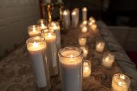 Burning candles on church altar