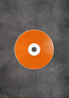 Orange CD - DVD mockup template isolated on concrete background