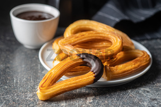 Tasty fried churros with chocolate dip.
