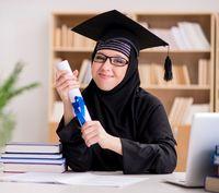 Muslim girl in hijab studying preparing for exams