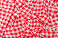 Red checkered kitchen towel. Beautiful decorative folds.