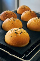 Freshly baked homemade burger buns with sesame