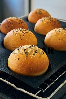 Freshly baked homemade burger buns with sesame