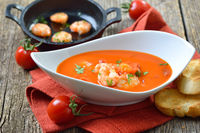 Cream of tomato soup with fried prawns