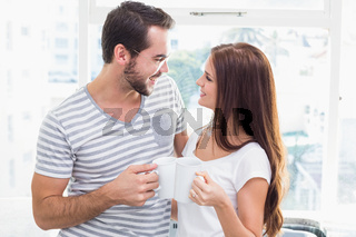 Young couple toasting their coffees