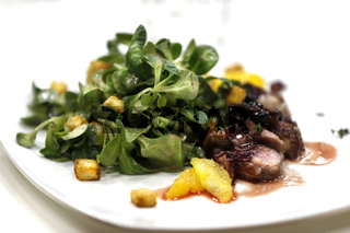 Greens with grilled meat.Beautiful food on a white plate