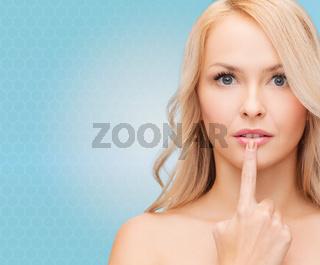 beutiful young woman touching her lips