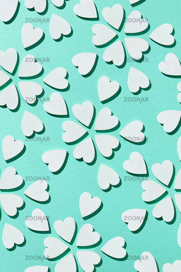Flowering pattern made from plaster hearts with shadows.