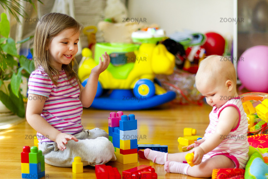 Sisters playing with toys at home