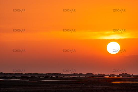 Beautiful orange colored sunset at the seaside