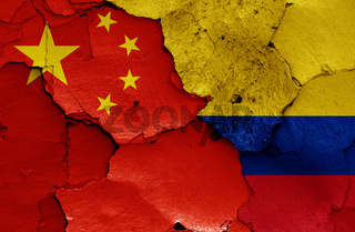 flags of China and Colombia painted on cracked wall