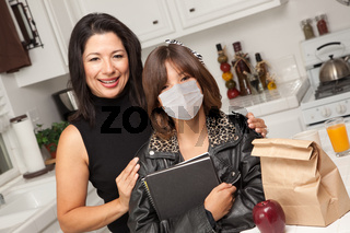 Young Hispanic Girl Student with Mother At Home Getting Ready For School Wearing Medical Face Mask