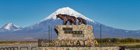 Sculpture of Kamchatka brown bear family She bear and bear cub, inscription: Here begins Russia. Kamchatka. Panoramic view monument on background of volcano