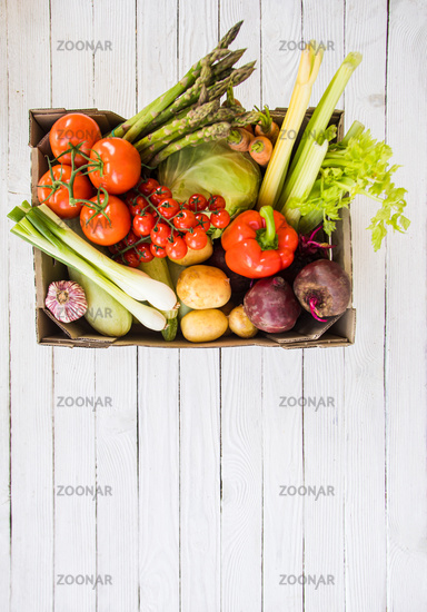 Assortment of organic vegetables in box, overhead