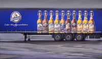The beer advertisement on the trailer. . .