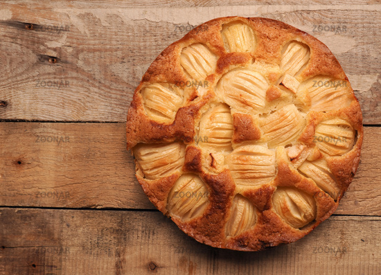 Delicious homemade organic apple pie on a rustic kitchen table, view from above