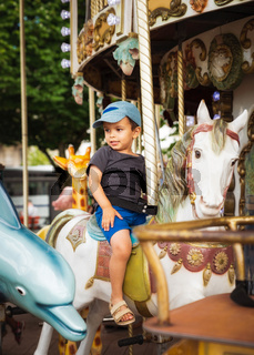 Little boy on carousel horse