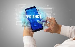 Hand using smartphone with social media concept
