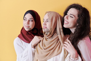muslim women in fashionable dress isolated on yellow