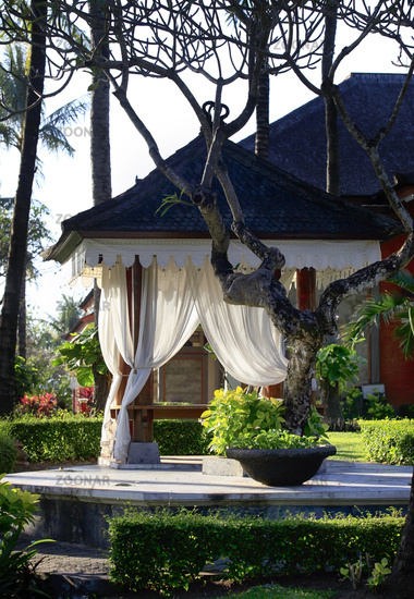 Arbor with white curtains for relaxation or meditation. Bali Island, Indonesia