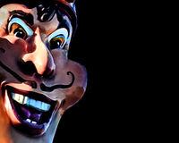 Evil Expression Caricature Over Black Background