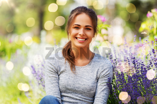 young woman with flowers at summer garden