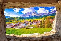 Beautiful landscape of Cortina d' Ampezzo in Dolomites Alps view through stone window
