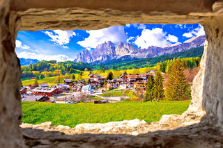 Beautiful landscape of Cortina d' Ampezzo in Dolomites Alps view through stone window