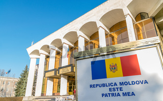 The Palace of the Republic building in Chisinau with Moldovian Flag in front. It is an official multi-purpose building as well as a concert and theatre hall in Chisinau, Moldova