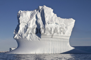 rectangular iceberg sunny summer day in Antarctic waters